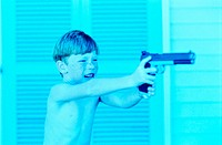 Boy Aiming a Toy Gun