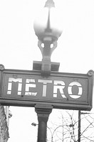 Paris, France, metro sign and lamp, close-up (B&W)