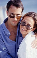 Couple wearing sunglasses, portrait