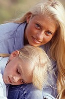 Mother and daughter (8-9) in countryside, portrait