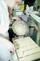 Chef pouring mixture onto tray