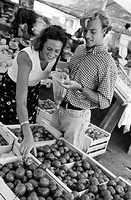 Couple food shopping at market (B&W)