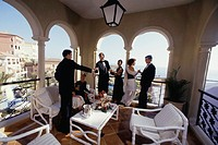 Group of people drinking champagne on veranda