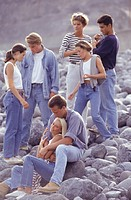 Group of young people on pebble beach
