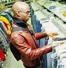 Young man shopping in thrift store