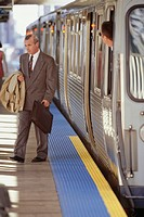Businessman exiting train