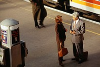 Business people talking at train platform