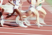 Seoul Olympics, group of runners racing, focus on legs, (blurred motion)
