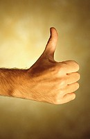 Man giving thumbs-up sign, Close-up of hand