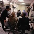 Businesspeople in network server room