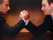 Businessmen arm wrestling, (Close-up)