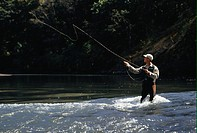 Man fly fishing on lake
