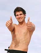 Man with thumbs up, naked chest