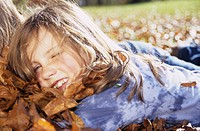 Girl lying on autumn leafs