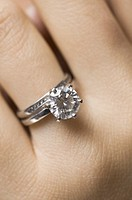 Close-up of a diamond ring on a woman´s finger