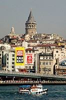 Boat crossing the Bosphorous with the Galata Tower in the background. Istanbul. Turkey (september 2005)