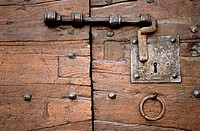 Old lock on a wooden door, Gubbio. Umbria, Italy