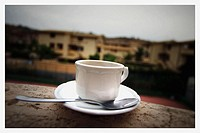 Coffee cup and saucer on ledge in Sicily. Italy