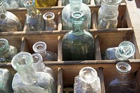 Antique bottles in wooden box