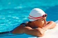 Female Swimmer Leaning on Poolside