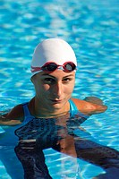 Female Swimmer Floating in Pool