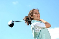 Portrait of a young woman holding a golf club