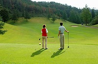 Couple looking down the fairway from the tee ground
