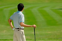 Male golfer contemplating his shot