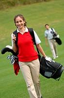 Female golfer walking down the fairway