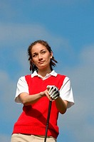 Portrait of a female golfer on a sunny day