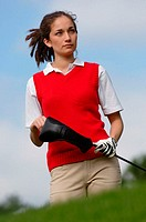 Portrait of a female golfer holding a golf club