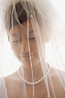 Bride wearing veil smiling
