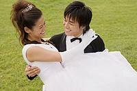 Groom carrying bride
