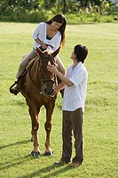 Couple horse riding