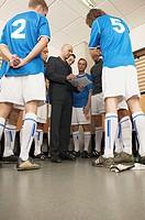 Coach with football team