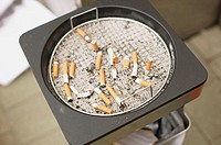 Cigarette butts in bin