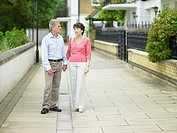 Couple holding hands in a suburban street