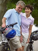Mature couple with bicycles (thumbnail)