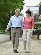 Mature couple walking hand in hand (thumbnail)
