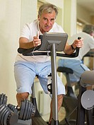 Mature man on an exercise bike