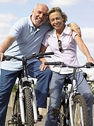 Mature couple on bikes
