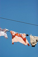 Children clothes hanging to dry on clothesline