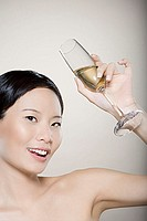 Woman raising her champagne glass