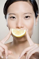 Woman with lemon slice smile