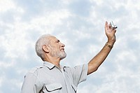 Man taking a picture of the sky
