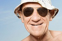 Senior man wearing sunhat and sunglasses