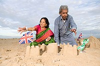 Couple making sandcastles