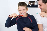Father and son brushing teeth (thumbnail)
