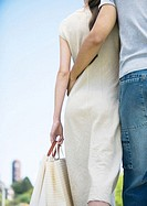 Young couple walking with shopping bags