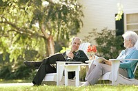 Senior couple relaxing in their backyard